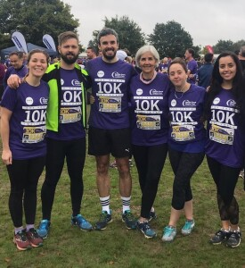 Jo (right of centre) and her team taking part in last year's Herts 10K for her mum